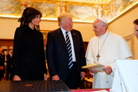 Pope Francis exchanges gifts with President Donald Trump and first lady Melania Trump during a private audience at the Vatican on May 24, 2017.