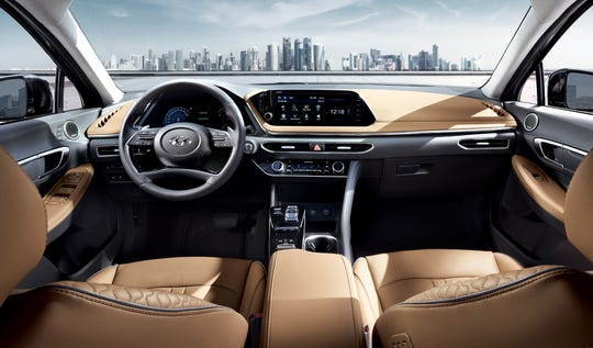 Inside, the Sonata has upscale features and an elegant-looking dashboard sweep.