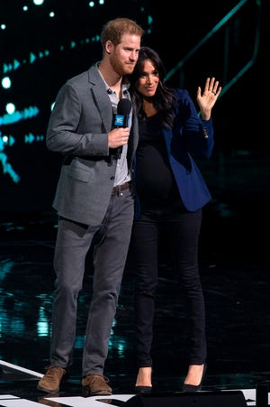 Prince Harry and Duchess Meghan appear on stage during WE Day at Wembley Arena, London, Britain on March 6, 2019.