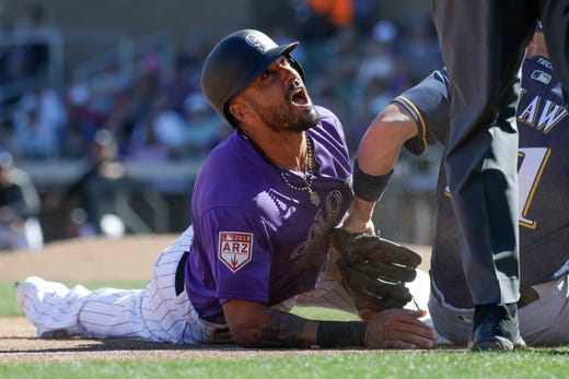 March 5: Rockies'Ian Desmond reacts after getting tagged out stealing third by Brewers third baseman Travis Shaw.