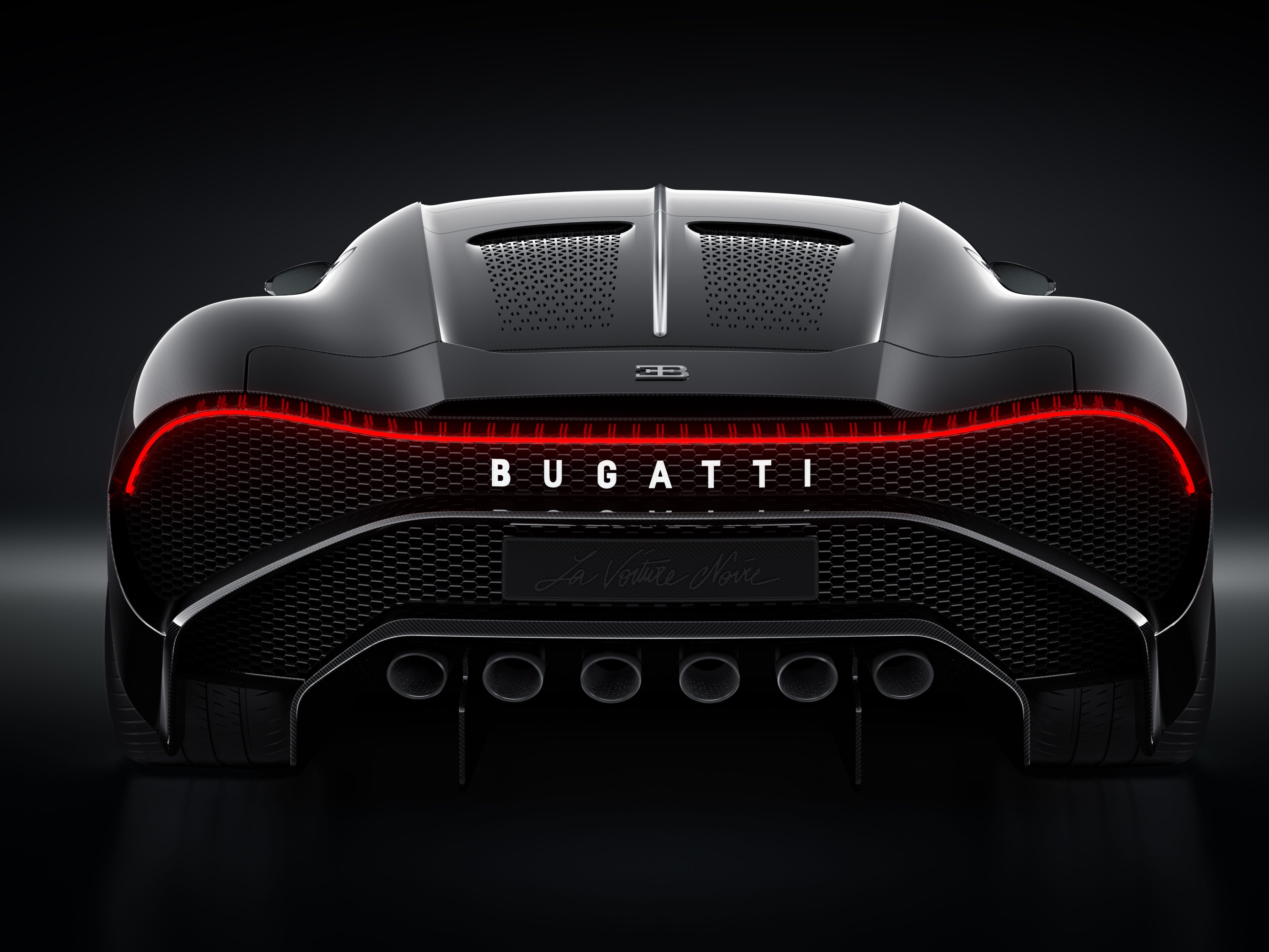 At the rear, the company name is illuminated in white atop the perforated panel that covers the engine.