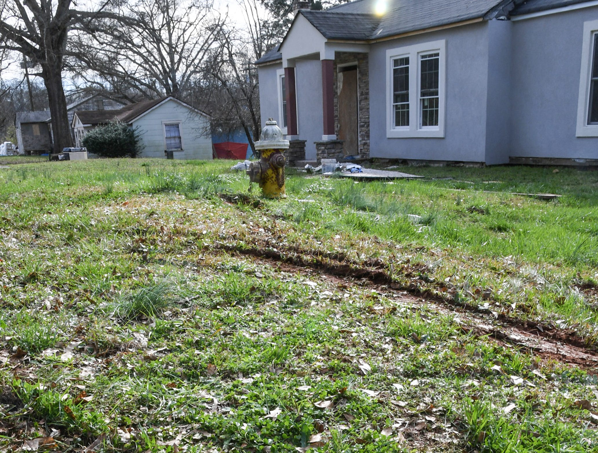 Tire tracks from a car involved in a shooting on the 400 block of River Heights Circle in Anderson Thursday.