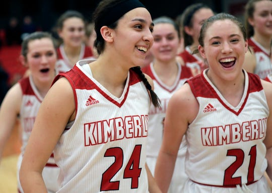 Kimberly's Shea Dechant (24) and Kate Karch (21) celebrate a victory against Appleton North earlier this season. The Papermakers will play Bay Port on Friday in the state semifinals.