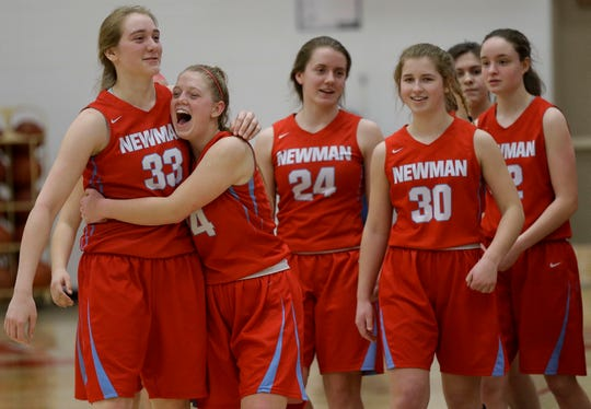 Newman Catholic's Jadelyn Ganski (33) and Jaida Heinz (14) react after beating Wausaukee in a WIAA Division 5 sectional final Saturday at Wausau East High School.