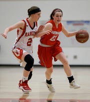 Newman Catholic's Lauren Shields (23) dribbles past Wausaukee's Stephanie Murray (2) in a Division 5 sectional final game.