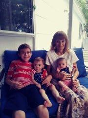 Karen Santore with daughter Holly Santore's children: Nicholas Santore (9 years old, far left), Aliyah Sullivan (2 years old, center) and Samantha Sullivan (10 months old, right)