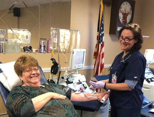 Melissa O'Malley (left) as the first platelet donor in Monmouth County for New Jersey Blood Services on Feb. 28. Right is Cathi Bradley, donor specialist.