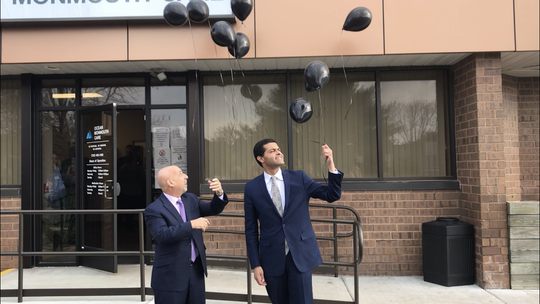 Health Commissioner Shereef Elnahal and Joe Pritchard, CEO of Pinnacle Treatment Centers, release black balloons to commemorate those lost to addiction