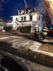 Flames tore through a three-story home on Sunset Avenue in Asbury Park early March 7.