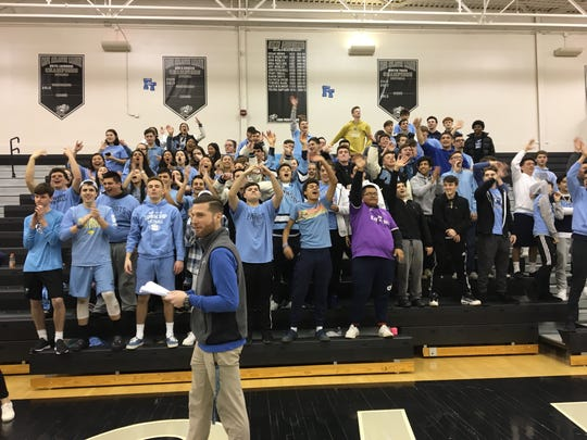 The Freehold Township student section celebrates the win over Cherokee in the Group IV State Semifinals on March 6, 2019 at Egg Harbor Township High School.