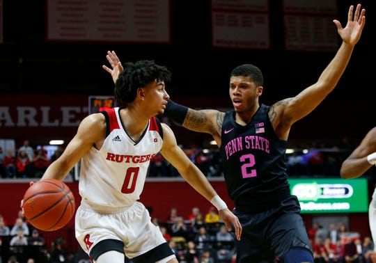 Penn State Nittany Lions guard Myles Dread (2) defends against Rutgers Scarlet Knights guard Geo Baker (0) during the first half at Rutgers Athletic Center.