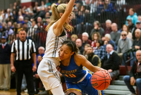 Manchester's Kemari Reynolds drive to the basket during first half action. Manchester Girls Basketball vs Manasquan in NSIAA Group II Semifinal in Berkeley NJ on March 7, 2019