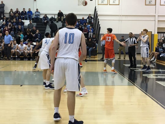 Freehold Township's Seth Meisner gets ready to inbound the ball while Cherokee's Anthony DiCaro gets ready to defend the play.