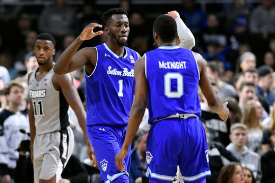 Seton Hall Pirates forward Michael Nzei (1) and guard Quincy McKnight (0) react after scoring against the Providence Friars
