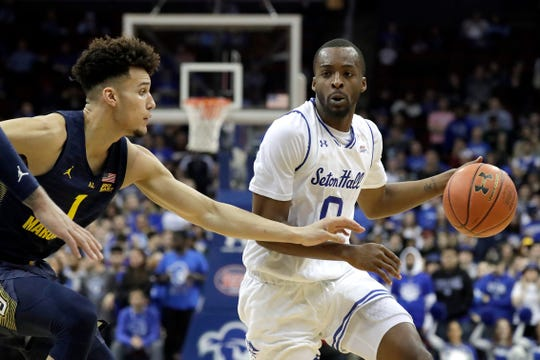 Seton Hall guard Quincy McKnight, right, drives against Marquette forward Brendan Bailey (1)