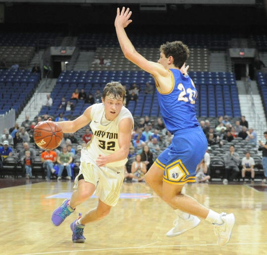 Jayton's Tye Scogin drives past Nazareth forward Jake Gerber in a Class 1A semifinal Thursday, March 7, 2019 at the Alamodome.
