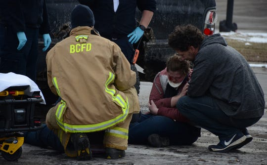 One of two teenagers injured in a crash Thursday is comforted before being taken to the hospital.