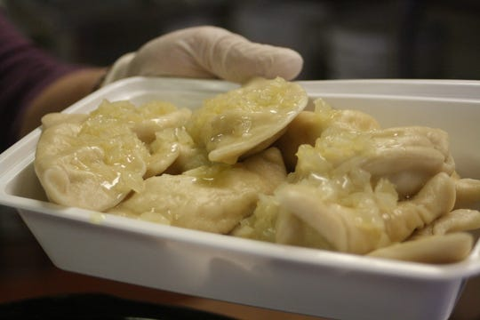 Pirohis at St. Michael's Church in Binghamton are topped with a mixture of butter and onions.
