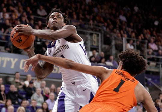 Washington forward Nahziah Carter shoots against Oregon State guard Stephen Thompson Jr. (1) during the first half of an NCAA college basketball game Wednesday, March 6, 2019, in Seattle.