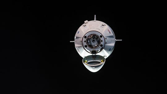 The uncrewed SpaceX Crew Dragon spacecraft is the first Commercial Crew vehicle to visit the International Space Station. Here it is pictured with its nose cone open revealing its docking mechanism while approaching the station's Harmony module on March 3, 2019.