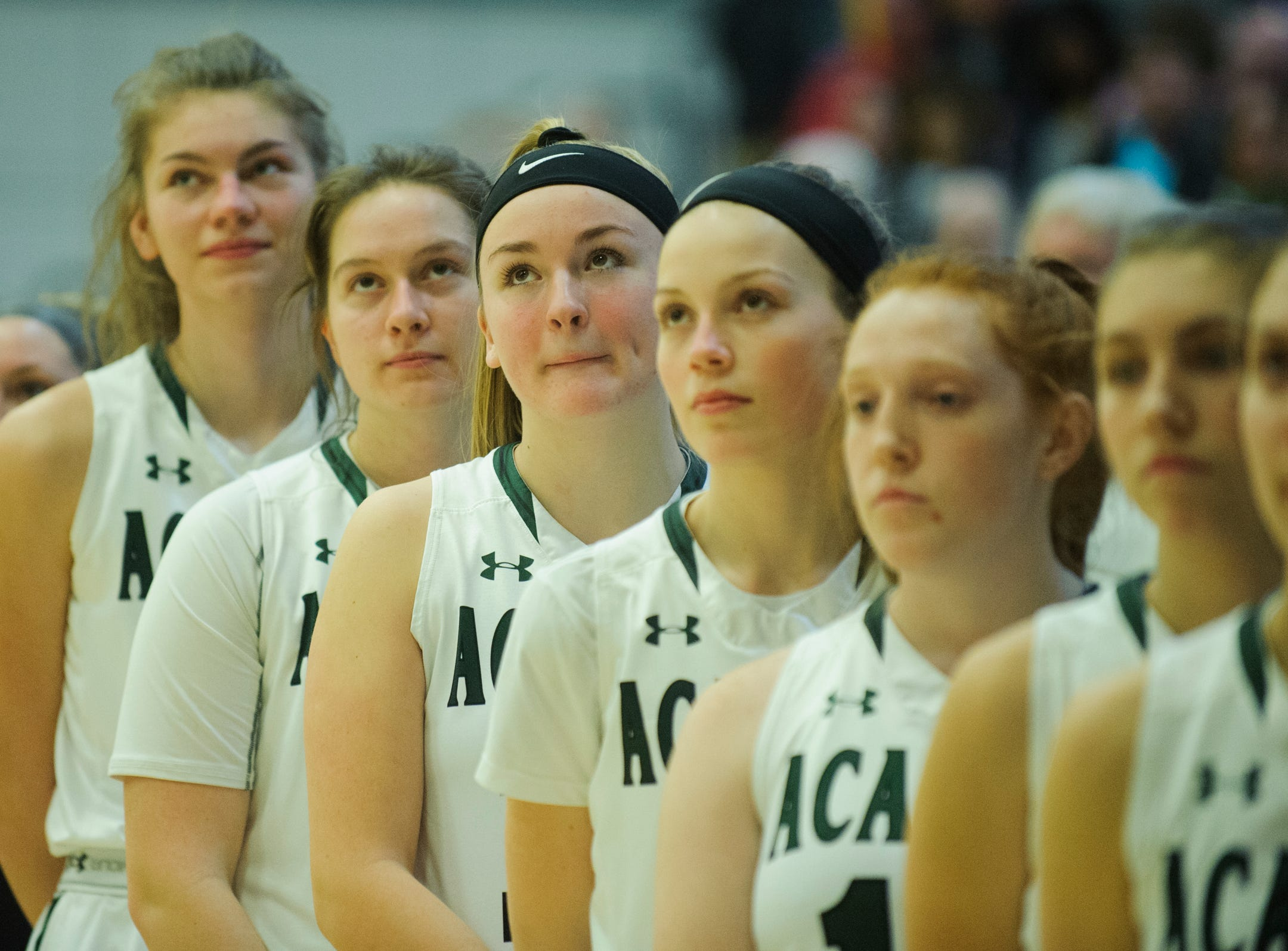 St. Johnsbury listens to the National Anthem during the girls semifinal basketball game between the BFA St. Albans Comets and the St. Johnsbury Hilltoppers at Patrick Gym on Wednesday night March 6, 2019 in Burlington, Vermont.