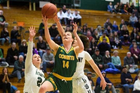 BFA's Caitlyn Dasaro (14) leaps for a layup during the Division I girls semifinal basketball game last year.