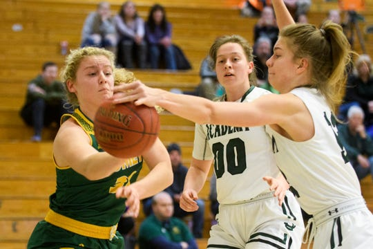 St. Johnsbury's Lara Rohkohl (12) blocks the pass by BFA's Kelly Laggis (30) during the girls semifinal basketball game between the BFA St. Albans Comets and the St. Johnsbury Hilltoppers at Patrick Gym on Wednesday night March 6, 2019 in Burlington, Vermont.