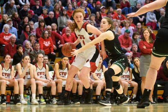 CVU's Catherine Gilwee (4) drives to the hoop past Rice's Sadie Vincent (3) during the girls semifinal basketball game between the Rice Green Knights and the Champlain Valley Union Redhawks at Patrick Gym on Wednesday nigh March 6, 2019 in Burlington, Vermont.