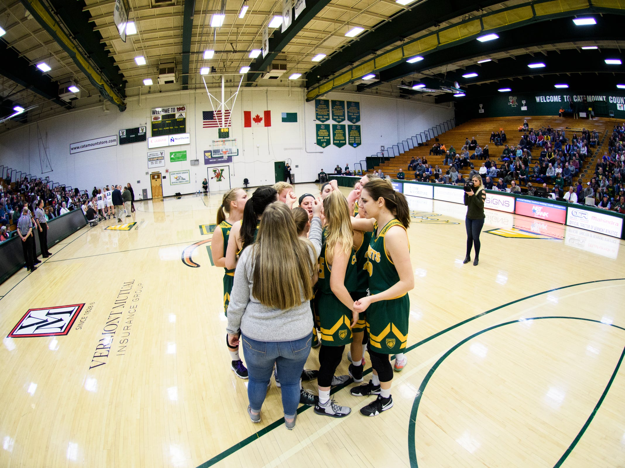 BFA huddles together during the girls semifinal basketball game between the BFA St. Albans Comets and the St. Johnsbury Hilltoppers at Patrick Gym on Wednesday night March 6, 2019 in Burlington, Vermont.