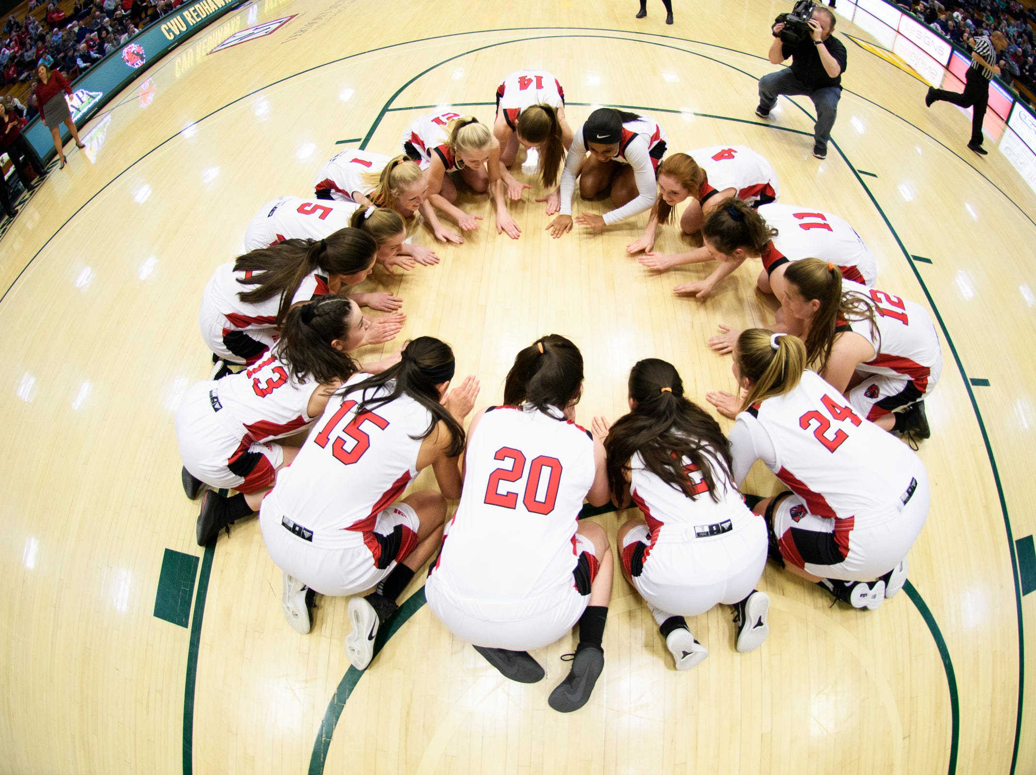 CVU huddles together during the girls semifinal basketball game between the Rice Green Knights and the Champlain Valley Union Redhawks at Patrick Gym on Wednesday nigh March 6, 2019 in Burlington, Vermont.