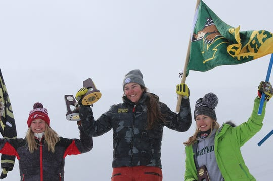 University of Vermont skier Laurence St. Germain, center, tops the podium after winning the NCAA giant slalom championship at Stowe Mountain Resort on Thursday.