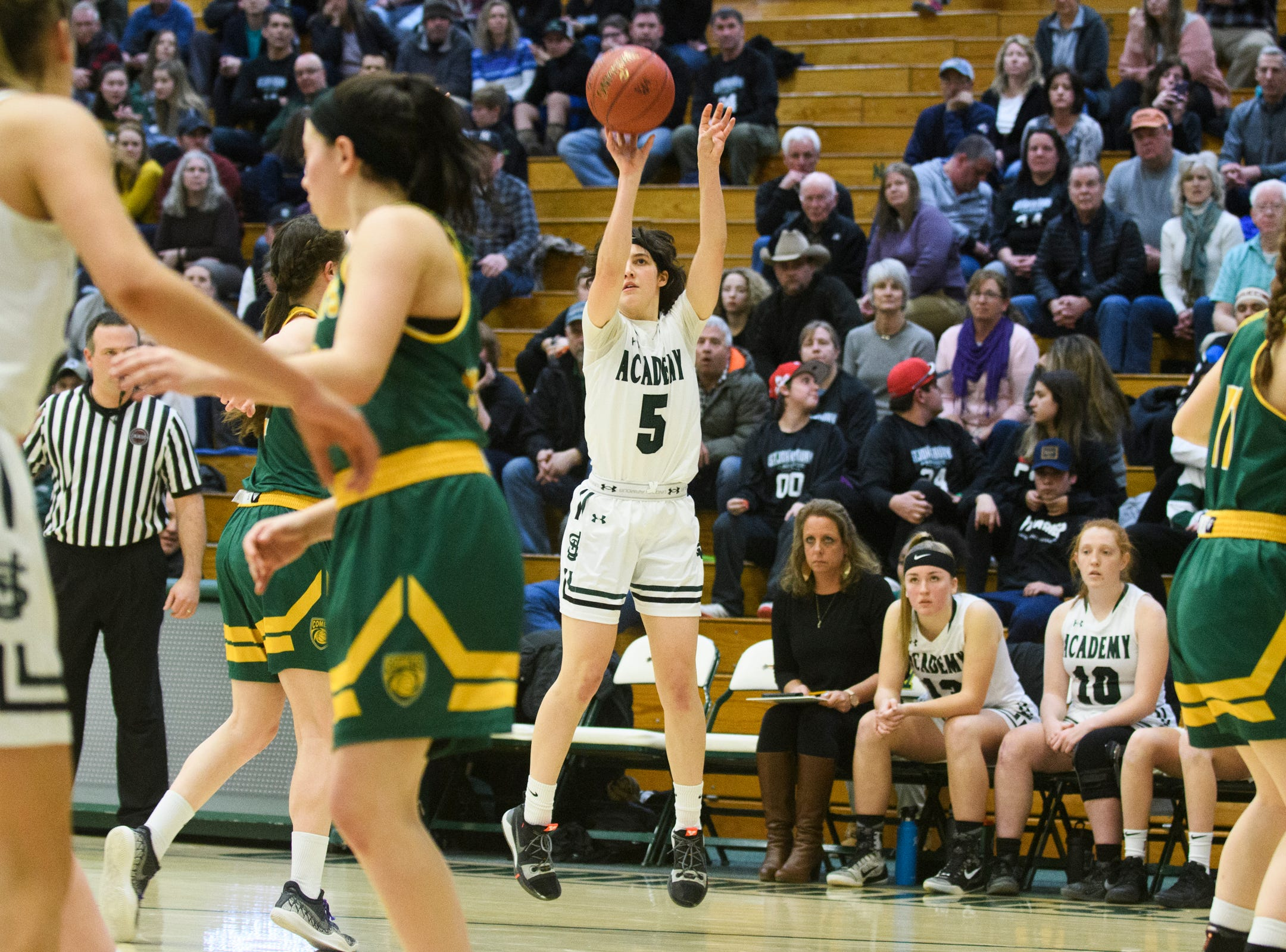 St. Johnsbury's Sadie Stetson (5) shoots the ball during the girls semifinal basketball game between the BFA St. Albans Comets and the St. Johnsbury Hilltoppers at Patrick Gym on Wednesday night March 6, 2019 in Burlington, Vermont.