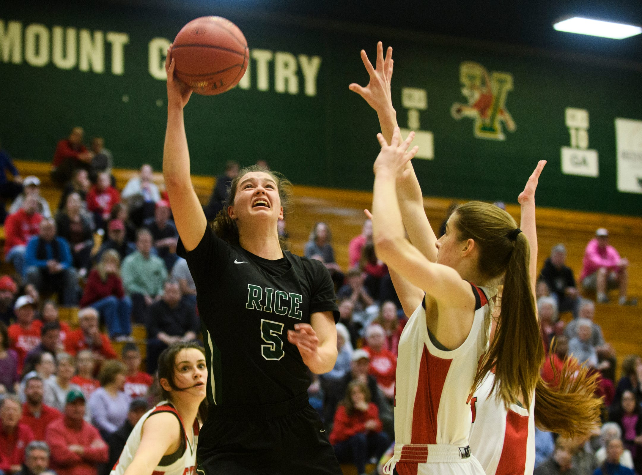 Rice's Petra Langan (5) leaps for a lay up during the girls semifinal basketball game between the Rice Green Knights and the Champlain Valley Union Redhawks at Patrick Gym on Wednesday nigh March 6, 2019 in Burlington, Vermont.