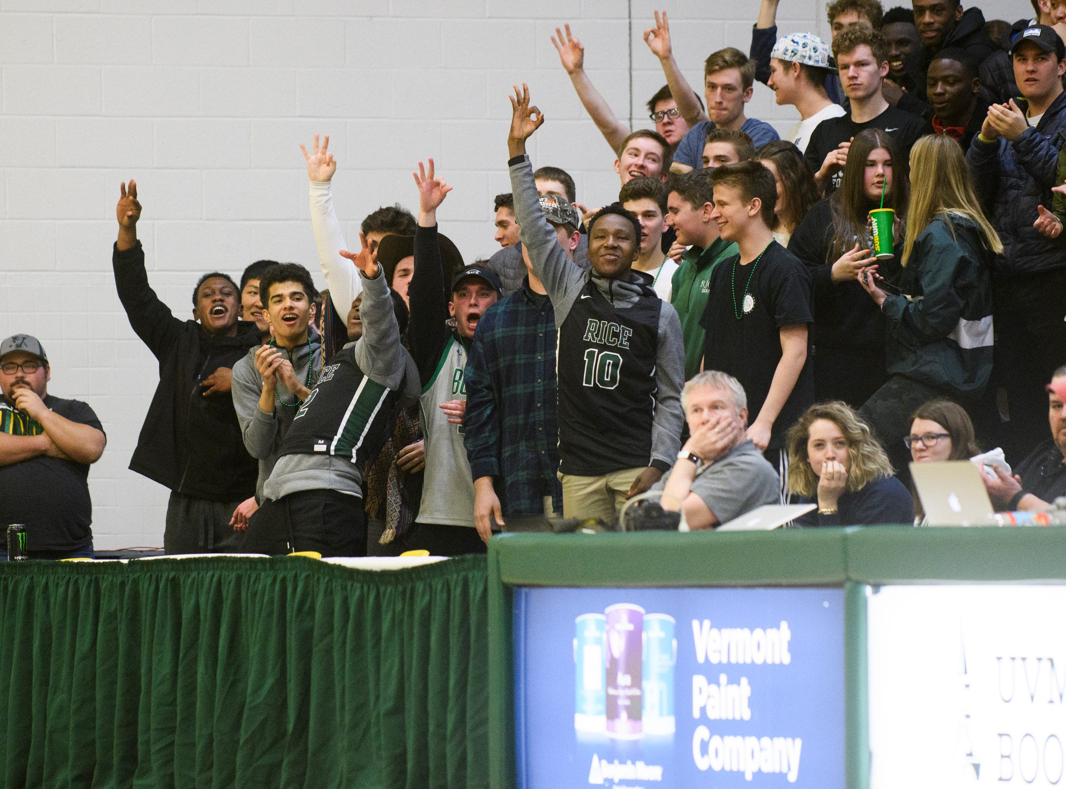 The Rice fans cheer for the team after a three pointer during the girls semifinal basketball game between the Rice Green Knights and the Champlain Valley Union Redhawks at Patrick Gym on Wednesday nigh March 6, 2019 in Burlington, Vermont.