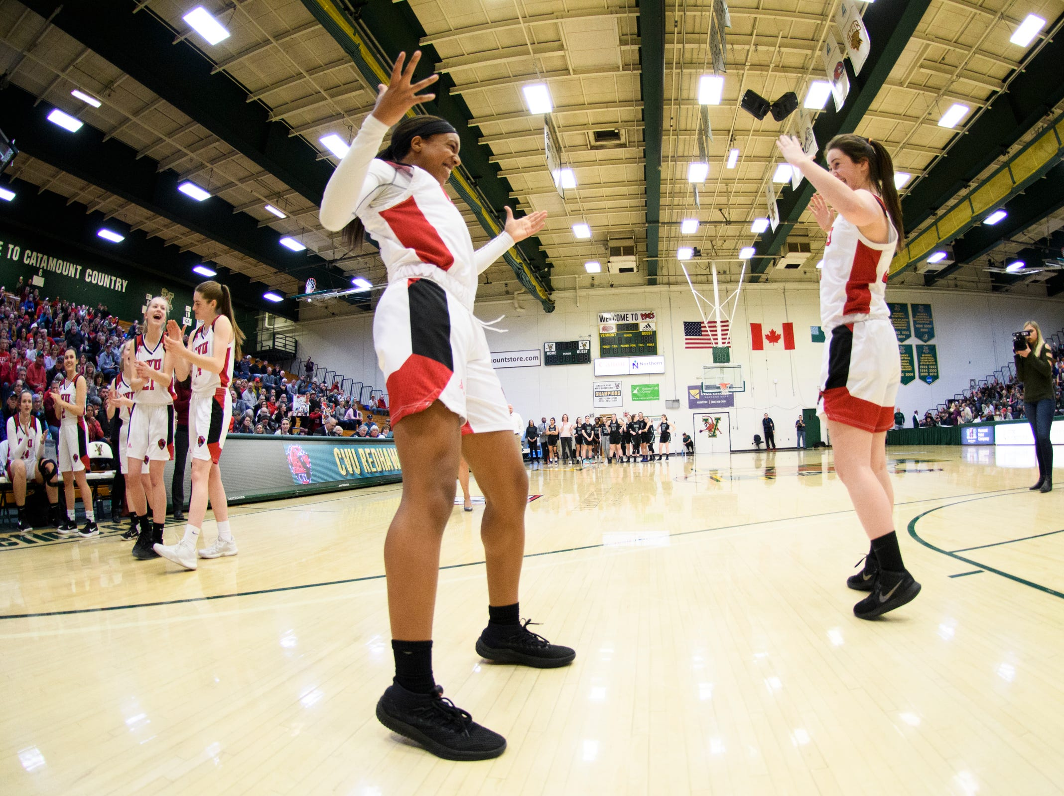 CVU's Mekkena Boyd (3) takes the court for player introductions during the girls semifinal basketball game between the Rice Green Knights and the Champlain Valley Union Redhawks at Patrick Gym on Wednesday nigh March 6, 2019 in Burlington, Vermont.