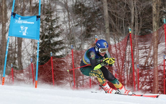 University of Vermont senior Laurence St. Germain skis her way to the NCAA giant slalom championship on Thursday at Stowe Mountain Resort.