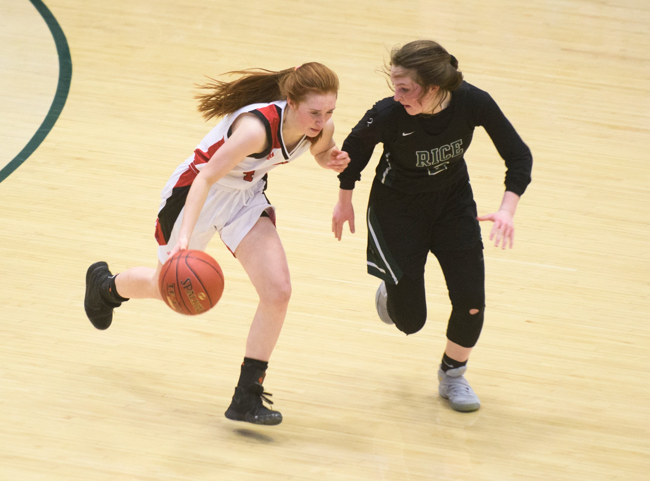 CVU's Catherine Gilwee (4) dribbles the ball down the court past Rice's Fiona Connolly (2) during the girls semifinal basketball game between the Rice Green Knights and the Champlain Valley Union Redhawks at Patrick Gym on Wednesday nigh March 6, 2019 in Burlington, Vermont.