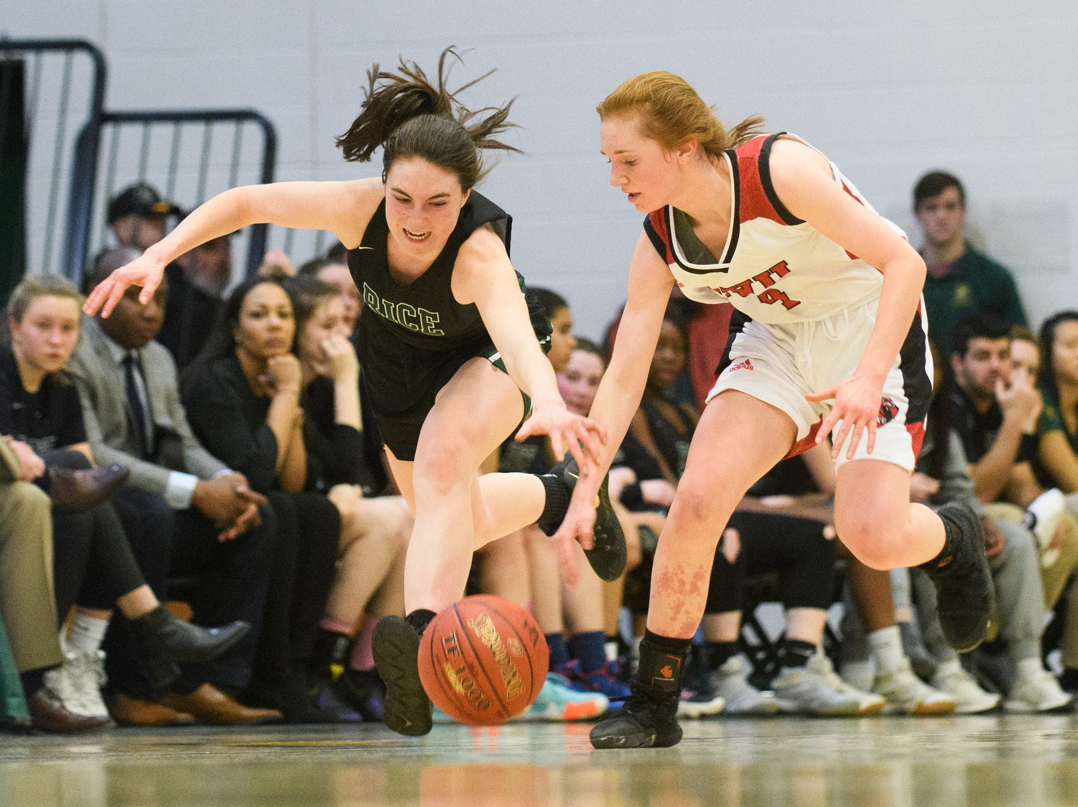 Rice's Kristen Varin (1) and CVU's Catherine Gilwee (4) battle for the loose ball during the girls semifinal basketball game between the Rice Green Knights and the Champlain Valley Union Redhawks at Patrick Gym on Wednesday nigh March 6, 2019 in Burlington, Vermont.
