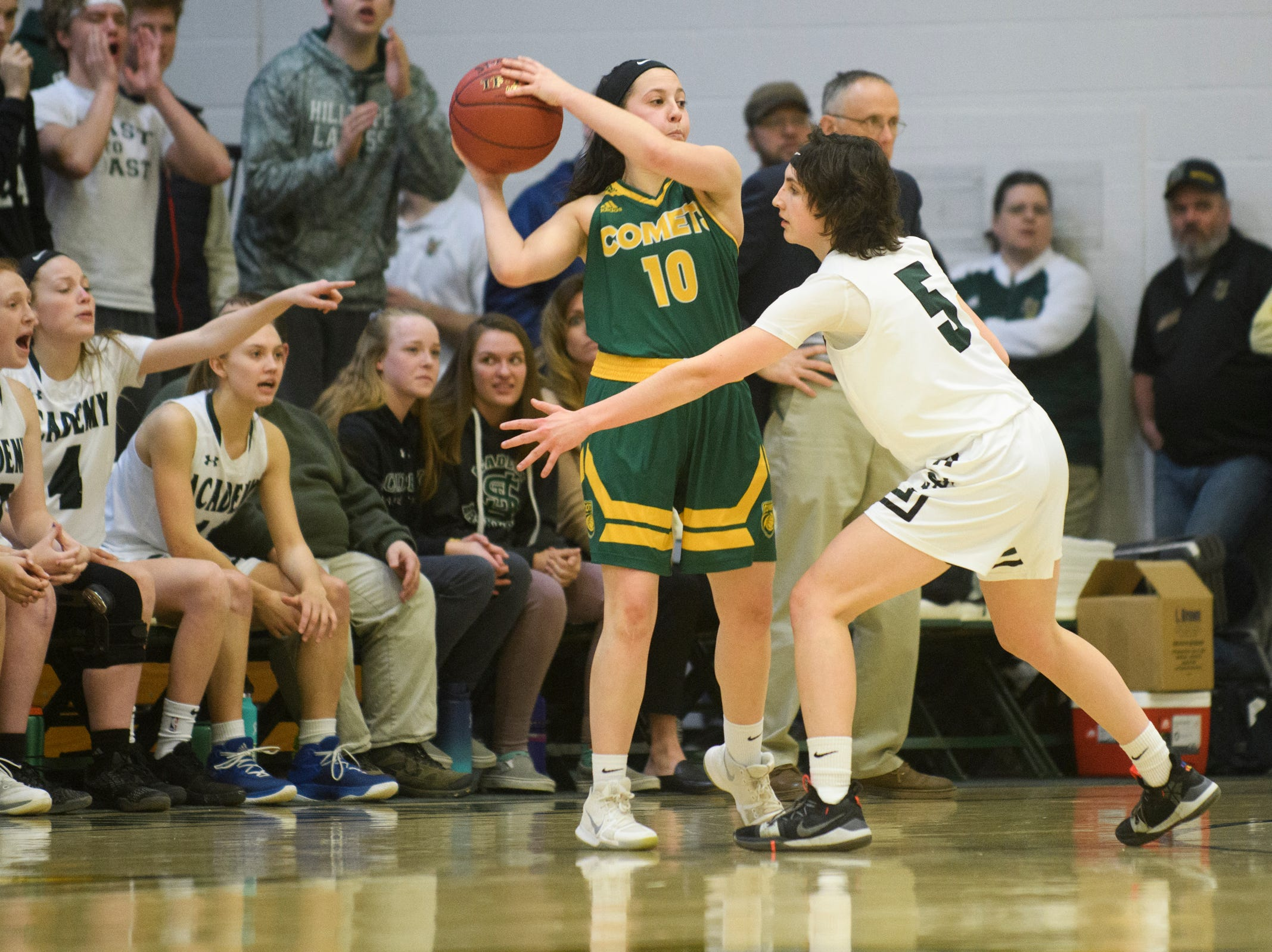 BFA's Leah Larivee (10) looks to pass the ball past St. Johnsbury's Sadie Stetson (5) during the girls semifinal basketball game between the BFA St. Albans Comets and the St. Johnsbury Hilltoppers at Patrick Gym on Wednesday night March 6, 2019 in Burlington, Vermont.
