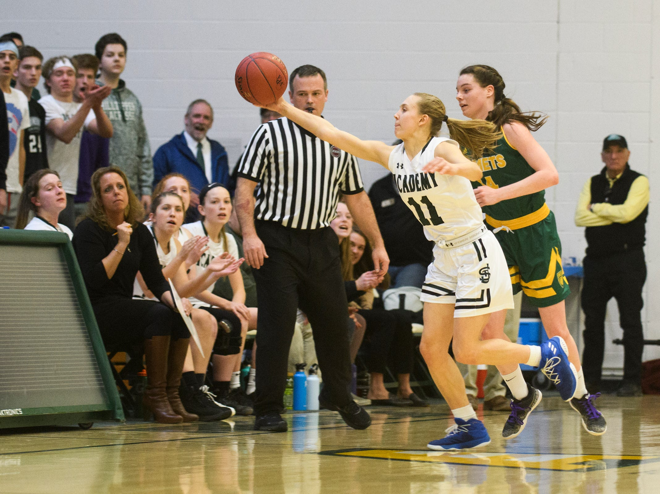 St. Johnsbury's Sydney Huntington-Strohm (11) steals the ball during the girls semifinal basketball game between the BFA St. Albans Comets and the St. Johnsbury Hilltoppers at Patrick Gym on Wednesday night March 6, 2019 in Burlington, Vermont.