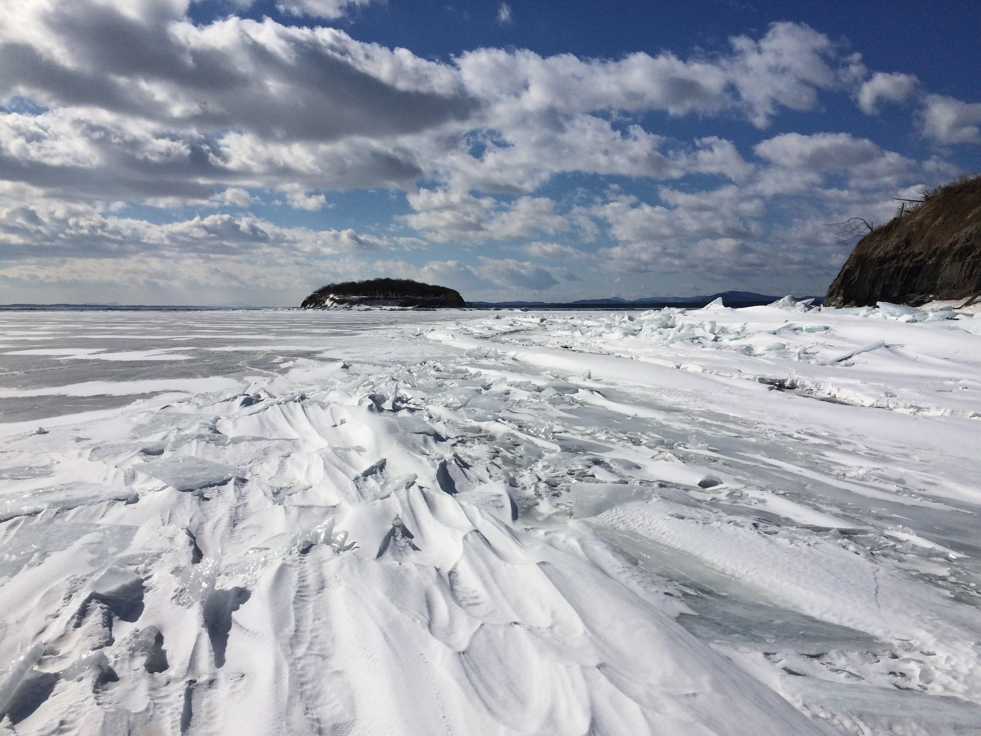 Wind-blown snow covers ice near the Four Brothers islands on Lake Champlain in this photograph taken in 2015.