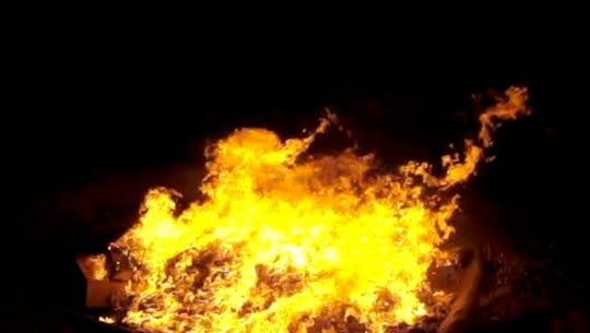 Vermont National Guardsmen burn trash in a 'burn pit' in Afghanistan in 2010.