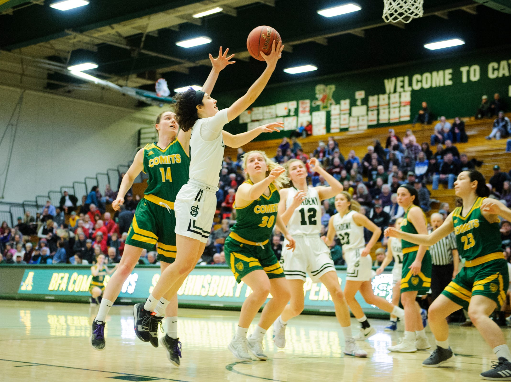 St. Johnsbury's Sadie Stetson (5) leaps for a lay up during the girls semifinal basketball game between the BFA St. Albans Comets and the St. Johnsbury Hilltoppers at Patrick Gym on Wednesday night March 6, 2019 in Burlington, Vermont.
