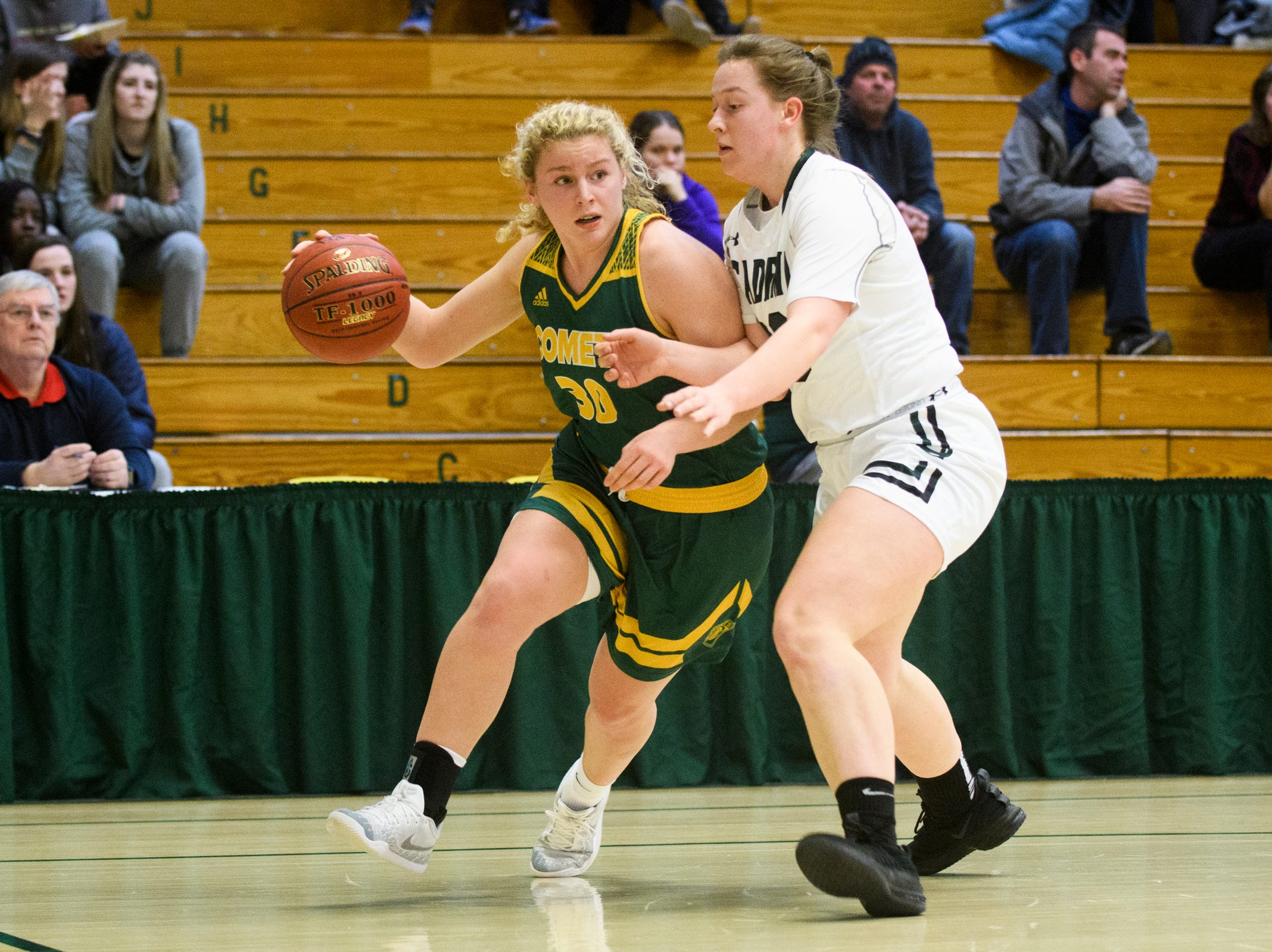 BFA's Kelly Laggis (30) drives to the hoop past St. Johnsbury's Saleena Porter (00) during the girls semifinal basketball game between the BFA St. Albans Comets and the St. Johnsbury Hilltoppers at Patrick Gym on Wednesday night March 6, 2019 in Burlington, Vermont.