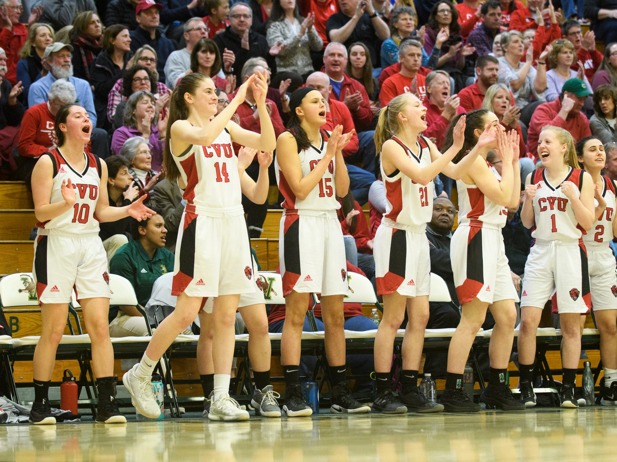 The CVU bench cheers for the team during the girls semifinal basketball game between the Rice Green Knights and the Champlain Valley Union Redhawks at Patrick Gym on Wednesday nigh March 6, 2019 in Burlington, Vermont.