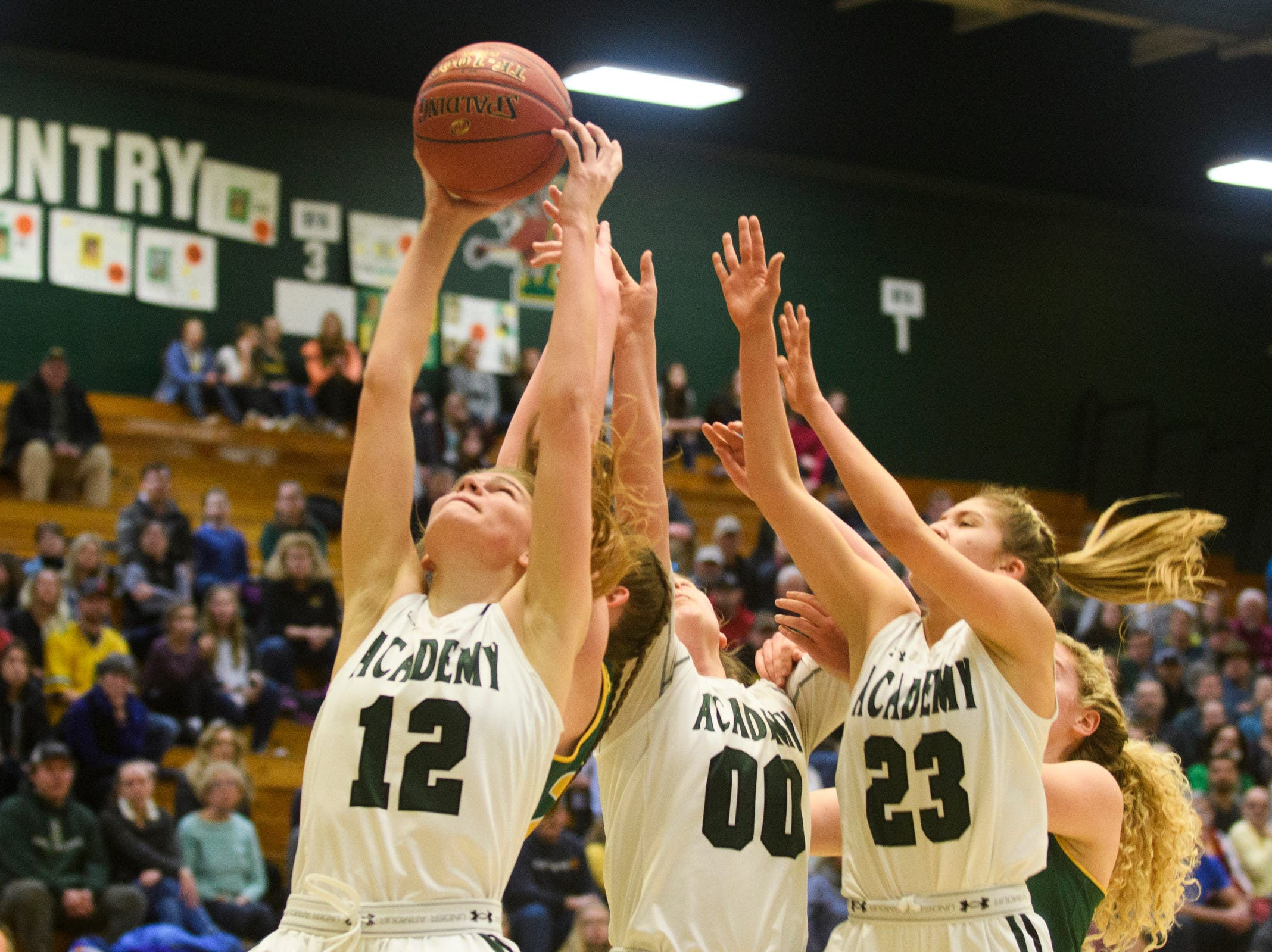 St. Johnsbury's Lara Rohkohl (12) leaps to grab the rebound during the girls semifinal basketball game between the BFA St. Albans Comets and the St. Johnsbury Hilltoppers at Patrick Gym on Wednesday night March 6, 2019 in Burlington, Vermont.