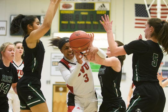 CVU's Mekkena Boyd (3) loses the ball in traffic during the girls semifinal basketball game between the Rice Green Knights and the Champlain Valley Union Redhawks at Patrick Gym on Wednesday nigh March 6, 2019 in Burlington, Vermont.