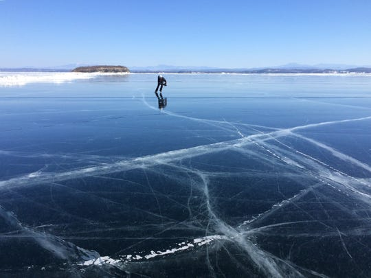 Diana Hanks of Burlington skates west across the broad stretch of Lake Champlain in 2015.