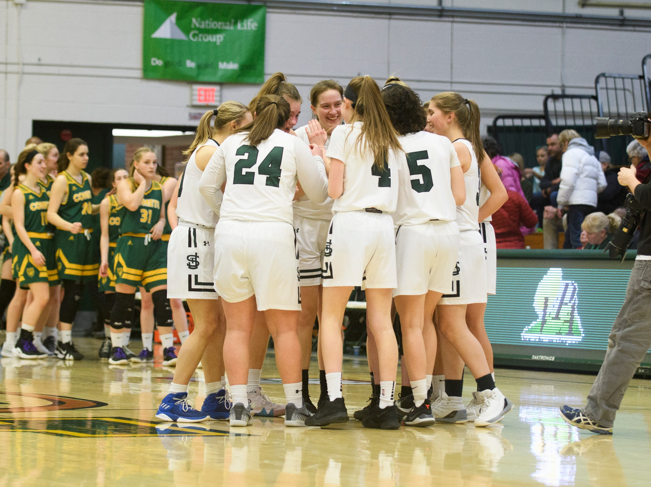 St. Johnsbury huddles together at the conclusion of the girls semifinal basketball game between the BFA St. Albans Comets and the St. Johnsbury Hilltoppers at Patrick Gym on Wednesday night March 6, 2019 in Burlington, Vermont.