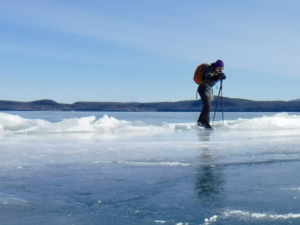 "Phyl Newbeck of Jericho crosses a pressure ridge on the ""inland sea"" of Lake Champlain on Feb. 10, 2019."